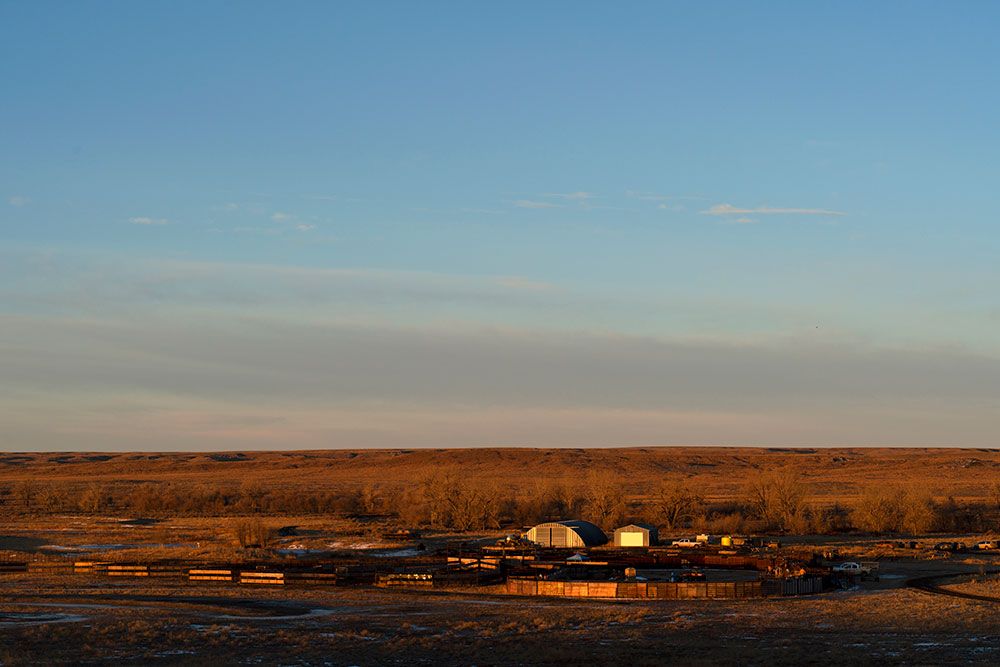 Sunrise on the American Prairie Reserve bison handling facility at Sun Prairie.